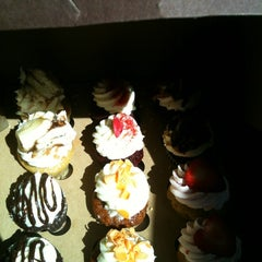 Photo taken at Indulgence Cupcakery by Vanessa R. on 4/8/2012