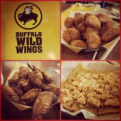 Photo taken at Buffalo Wild Wings by Renz N. on 6/9/2013