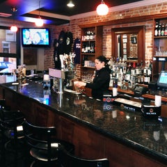 Photo taken at Yellow Dog Tavern by The Baltimore Sun on 12/6/2012