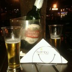 Photo taken at Bambu Resto Bar by Hernan G. on 4/14/2013