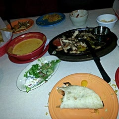 Photo taken at Rosie's Mexican Cantina by Mike W. on 12/20/2013