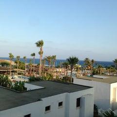 Photo taken at Adams Beach Hotel by Anastasiya Kaplina on 7/17/2013