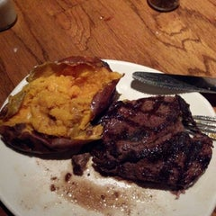 Photo taken at Outback Steakhouse by Christy R. on 1/30/2013