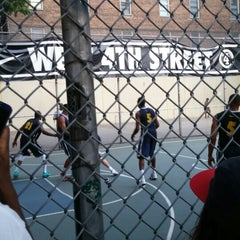 Photo taken at West 4th Street Courts (The Cage) by Michael D. on 6/14/2015