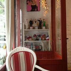 Photo taken at Café des Fleurs by Leandro O. on 5/18/2013