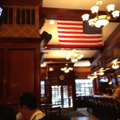 Photo taken at Annie Moore's Bar & Restaurant by Tatsu S. on 7/4/2013