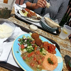 Photo taken at Lebanese Taverna Café by Lolly W. on 8/5/2013