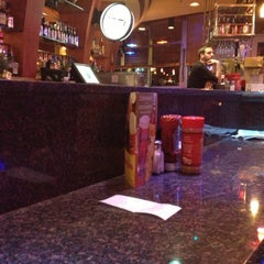 Photo taken at Red Robin Gourmet Burgers by Justine B. on 10/14/2012