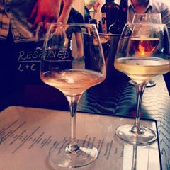 Photo taken at Loki Wine Merchant & Tasting House by Michael on 6/7/2014