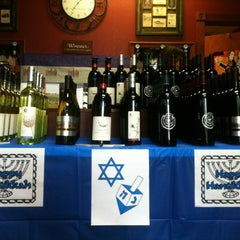 Photo taken at Vinously Speaking - An Eclectic Wine Shop & Blog by Robin E. on 12/8/2012