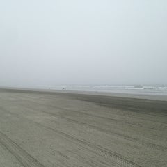 Photo taken at First Beach by Emily B. on 9/6/2014