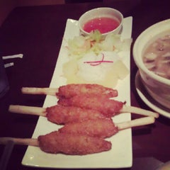 Photo taken at Cozy Thai Bistro by Justicy T. on 9/14/2012