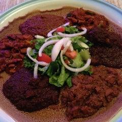 Photo taken at Gojo Ethiopian Restaurant by Lana P. on 10/1/2013