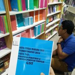 Photo taken at MPH Bookstore by Syima Kamal on 1/30/2015
