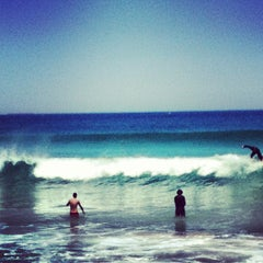 Photo taken at Scarborough Beach by Johan D. on 12/26/2012
