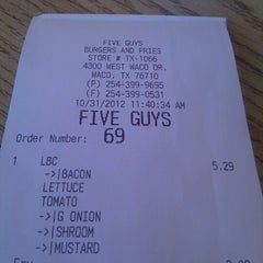 Photo taken at Five Guys by Michelle W. on 10/31/2012