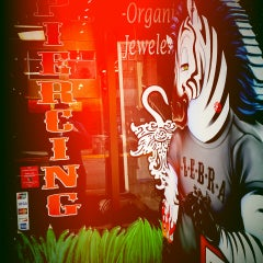 Photo taken at Zebra Tattoo & Body Piercing by Daryl B. on 2/11/2014