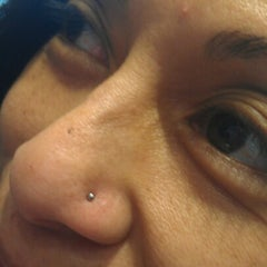 Photo taken at Zebra Tattoo & Body Piercing by Maile on 1/8/2013