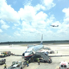 Photo taken at Aeropuerto Internacional De Cancún (CUN) by Denisse on 5/9/2013