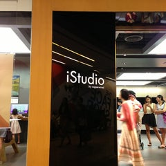 Photo taken at iStudio by Brian F. on 12/30/2012
