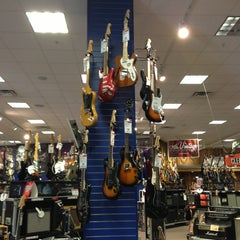 Photo taken at Guitar Center by Marie I. on 2/19/2013