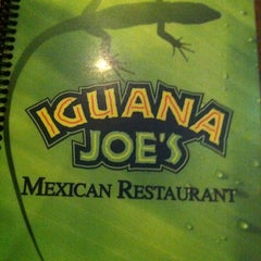 Photo taken at Iguana Joe's by Joey on 12/6/2012