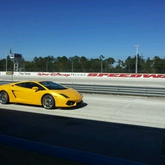 Photo taken at WDW Speedway - Richard Petty / Exotic Driving Experience by Matthew F. on 11/23/2012