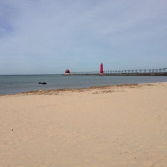 Photo taken at Grand Haven State Park by Xiaolin S. on 5/5/2013