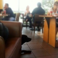Photo taken at Starbucks by Allan T. on 12/14/2012