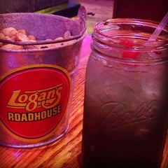 Photo taken at Logan's Roadhouse by Angela T. on 10/4/2014