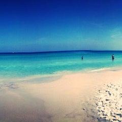 Photo taken at Praia Grande by Henrique V. on 5/5/2013