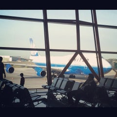 Photo taken at Gate E23 by Tommy Y. on 10/4/2012