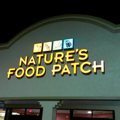 Photo taken at Nature's Food Patch Market & Cafè by Rob D. on 11/25/2012