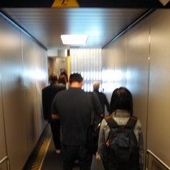 Photo taken at Gate 12 by Joel Richard E. on 6/11/2013