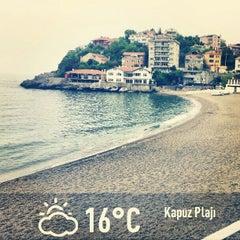 Photo taken at Kapuz Plajı by Emrah C. on 5/9/2013