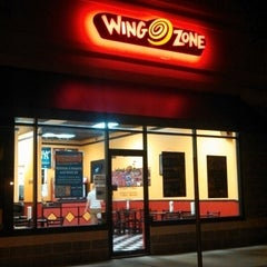 Photo taken at Wing zone by Bao on 7/21/2013