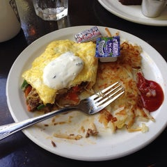 Photo taken at 808 Bistro Restaurant by Tim O. on 6/9/2014