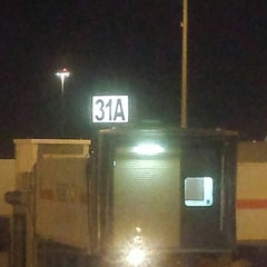 Photo taken at Gate 31 by Volodymyr S. on 2/2/2014
