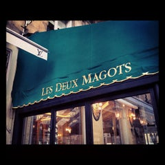 Photo taken at Les Deux Magots by Violetta on 11/6/2012