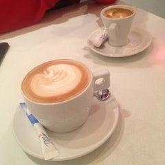 Photo taken at Caffé Nero by Jenny on 12/6/2012