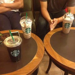 Photo taken at Starbucks (สตาร์บัคส์) by Amonrat S. on 8/27/2015