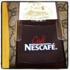 Photo taken at Café NESCAFÉ by luke r. on 10/9/2012