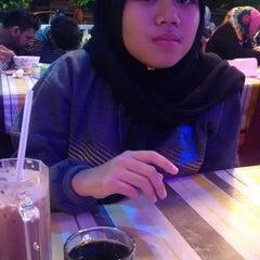 Photo taken at Banana Cafe by rKpeot on 12/31/2014