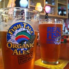 Photo taken at Fish Tale Brew Pub by Elena on 5/19/2013