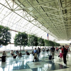 Photo taken at Charlotte Douglas International Airport (CLT) by Atif A. on 7/21/2013