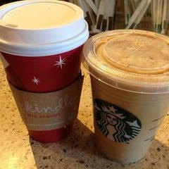 Photo taken at Starbucks by Yuri M. on 11/16/2012