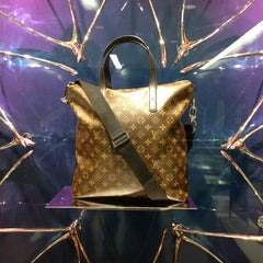 Photo taken at Louis Vuitton by Mónica C. on 12/24/2012