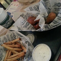 Photo taken at Wingstop by Bryan W. on 10/19/2012