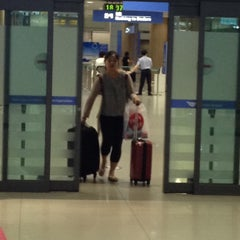 Photo taken at 인천국제공항 입국장 B (ICN Airport Arrival Exit B) by Tom C. on 7/23/2014