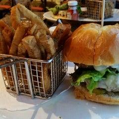 Photo taken at Delmonico's Kitchen by Christina C. on 9/30/2015